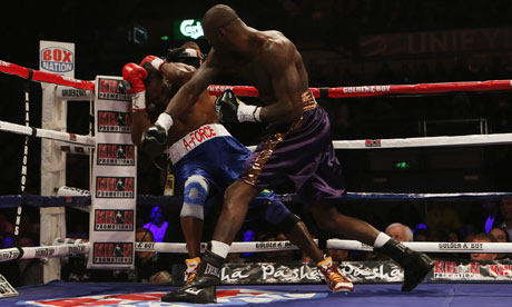 Deontay Wilder, right, knocks Audley Harrison down to win the fight at Motorpoint Arena, Sheffield.